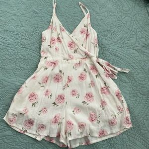 Floral romper with side tie detail!